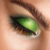Macro photo of closed eyes with professional green colors makeup Royalty Free Stock Photos