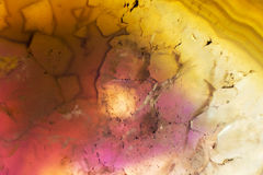 Macro photo of a colorful agate rock slice. Stock Images