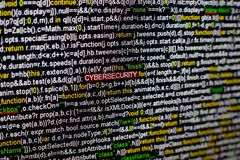 Macro photo of computer screen with program source code and highlighted CYBERSECURITY inscription in the middle. Script Royalty Free Stock Images