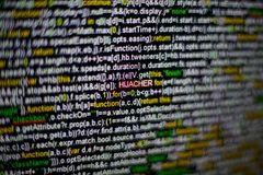 Macro photo of computer screen with program source code and highlighted HIJACKER inscription in the middle. Script on Royalty Free Stock Image