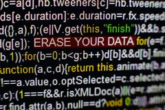 Macro photo of computer screen with program source code and highlighted SPYWARE inscription in the middle. Script on the Royalty Free Stock Photos