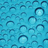 Macro photo of cyan chemical bubbles Royalty Free Stock Photography