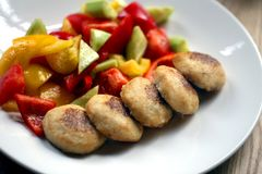 Macro photo of delicious pike burgers with vegetables on a white plate stock photos
