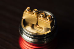 Macro photo of electronic cigarette. Macro photo of clapton coil mounted in the electronic cigarette royalty free stock photography