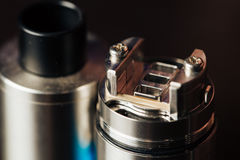 Macro photo of electronic cigarette. Macro photo of clapton coil mounted in the electronic cigarette Stock Photography