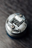 Macro photo of electronic cigarette. Macro photo of clapton coil mounted in the electronic cigarette Royalty Free Stock Photo
