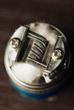 Macro photo of electronic cigarette. Macro photo of clapton coil mounted in the electronic cigarette Stock Images