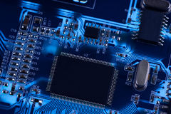 Macro photo of electronic circuit. PCB on the lighting. Stock Images