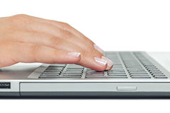 Macro photo of female hand typing on laptop Stock Photography