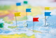 Macro photo with flag pushpins and world map.Travel concept Royalty Free Stock Photos
