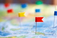 Macro photo with flag pushpins and world map.Travel concept Stock Images