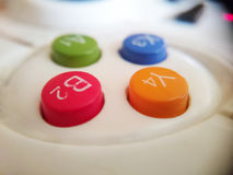 Macro photo of gamepad buttons. Close-up different  colored buttons Stock Photo