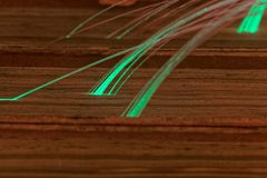 Glowing glass fiber cables connected with old books. Stock Image