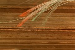 Glowing glass fiber cables connected with old books. Royalty Free Stock Images