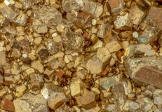 Macro photo of golden color pyrite cubes. Macro photo of golden color shiny pyrite cubes. Good for background wallpaper image stock photos