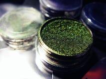 Macro photo green eye shadow pigment glitter gloss cosmetic make up.  Stock Photography