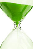 Macro photo of hourglass. Isolated on a white background Stock Images
