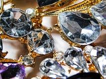Macro photo of large luxury silver rhinestones on a gold mount stock photo