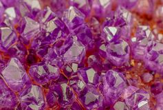 Macro photo of lavender color amethyst crystals. Good for background wallpaper image royalty free stock photography