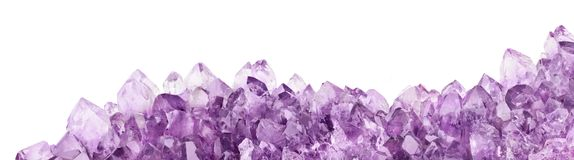 Isolated amethyst light crystals long stripe. Macro photo of lilac amethyst crystals isolated on white background stock photo