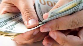 Macro image of man counting big stack of money royalty free stock photo
