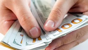 Macro image of man holding big stack of money in hands royalty free stock photos