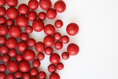 Macro photo of many red ball-shaped pills. Tibetan folk medicine from the herbal complex. Stock Images