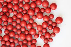 Macro photo of many red ball-shaped pills. Tibetan folk medicine from the herbal complex. Stock Photography
