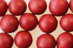 Macro photo of many red ball-shaped pills. Tibetan folk medicine from the herbal complex. Royalty Free Stock Photos