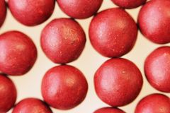 Macro photo of many red ball-shaped pills. Tibetan folk medicine from the herbal complex. Stock Photo
