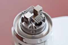 Macro photo of new clapton coil mounted in the electronic cigarette Royalty Free Stock Photos