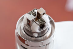 Macro photo of new clapton coil mounted in the electronic cigarette Royalty Free Stock Image
