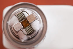 Macro photo of new clapton coil mounted in the electronic cigarette Royalty Free Stock Images