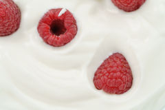 Macro photo of organic yogurt with fresh raspberries. Food background Stock Image