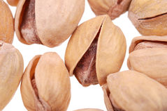 Macro photo of pistachios nuts on white Stock Photos