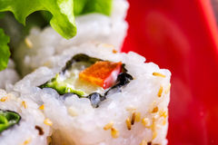 Macro photo of roll with vegitable Stock Images