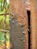 Macro photo of rusty metal, allowing to assess the level of wear of the iron object Stock Photo
