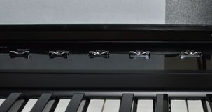 Macro photo of a satin black and white portable digital piano. Voice select buttons Stock Photography