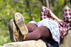 Macro photo of shoe soles. Girl resting on grass after a long physical activity. Macro photo of shoe soles. Girl resting on nature after a long physical activity royalty free stock photo