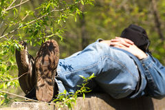 Macro photo of shoe soles. Man lying on stone after a long physical activity. Macro photo of shoe soles. Man lying on nature after a long physical activity stock photos