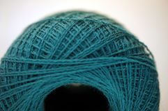 Macro photo shot from some nice fine merino yarn in teal color  macro shot Royalty Free Stock Images