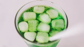 Nmacro photo of a soda with ice cubes in a glass close-up. Macro photo of a soda with ice cubes in a glass close-up Stock Photography
