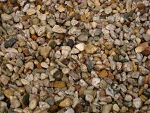 Macro photo of the texture of the light stone in the form of river pebbles Royalty Free Stock Image