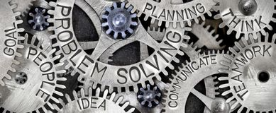Metal Wheel Concept. Macro photo of tooth wheel mechanism with PROBLEM SOLVING concept related words imprinted on metal surface Royalty Free Stock Photos
