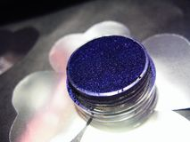 Macro photo violet blue eye shadow pigment glitter gloss cosmetic make up.  Stock Images