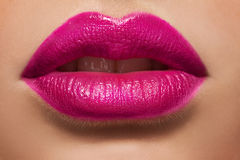 Macro photo of women's lips with pink lipstick Royalty Free Stock Photo