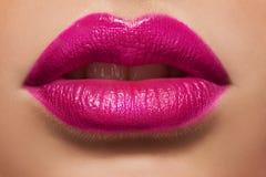 Macro photo of women's lips with pink lipstick Royalty Free Stock Photo