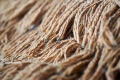 Macro photo of wool from the carpet. Homemade soft blanket royalty free stock image