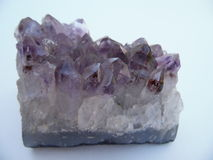 Macro Photograph of Mineral Quartz Amethyst. Amethyst, the purple variety, is the most popular and valuable Quartz gemstone.  Its purple coloring is usually Stock Photos