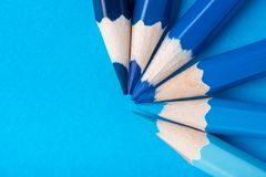 Macro photograph of several pencils of blue color on a paper bac Stock Image